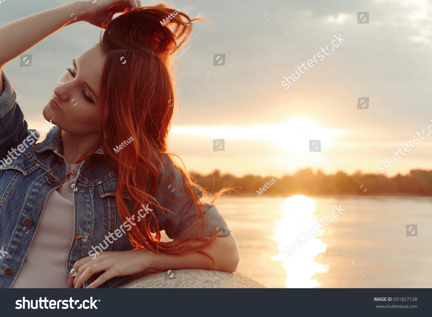 stock-photo-red-haired-woman-touch-her-l