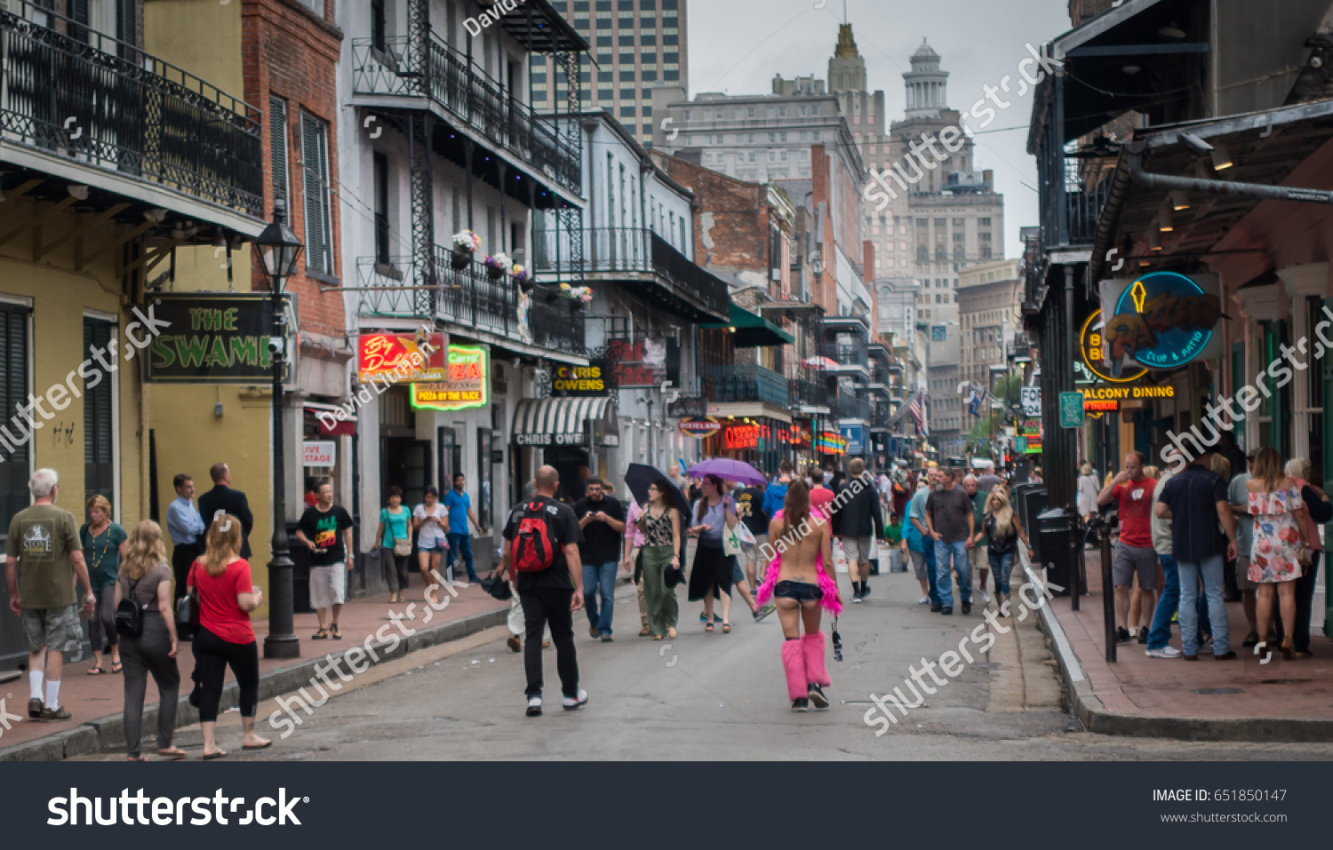 New Orleans, Louisiana, USA - May 22, 2017: People walk along Bourbon Street in the French Quarter, a destination famous for wild parties, Jazz music and people watching.
