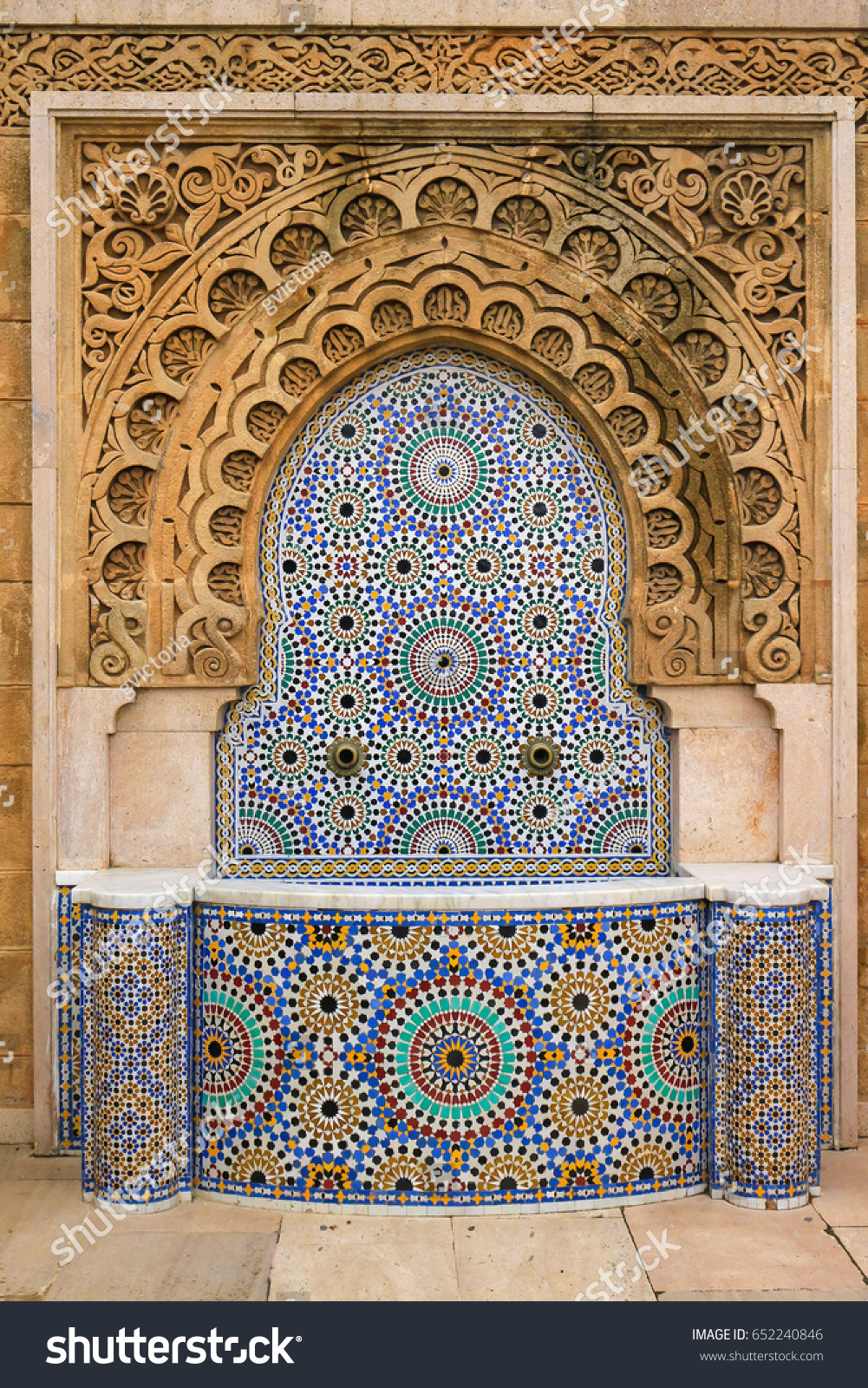 Beautiful decorative mosaic ceramic tile fountain stock photo beautiful decorative mosaic ceramic tile fountain with ornate arch in morocco africa dailygadgetfo Images