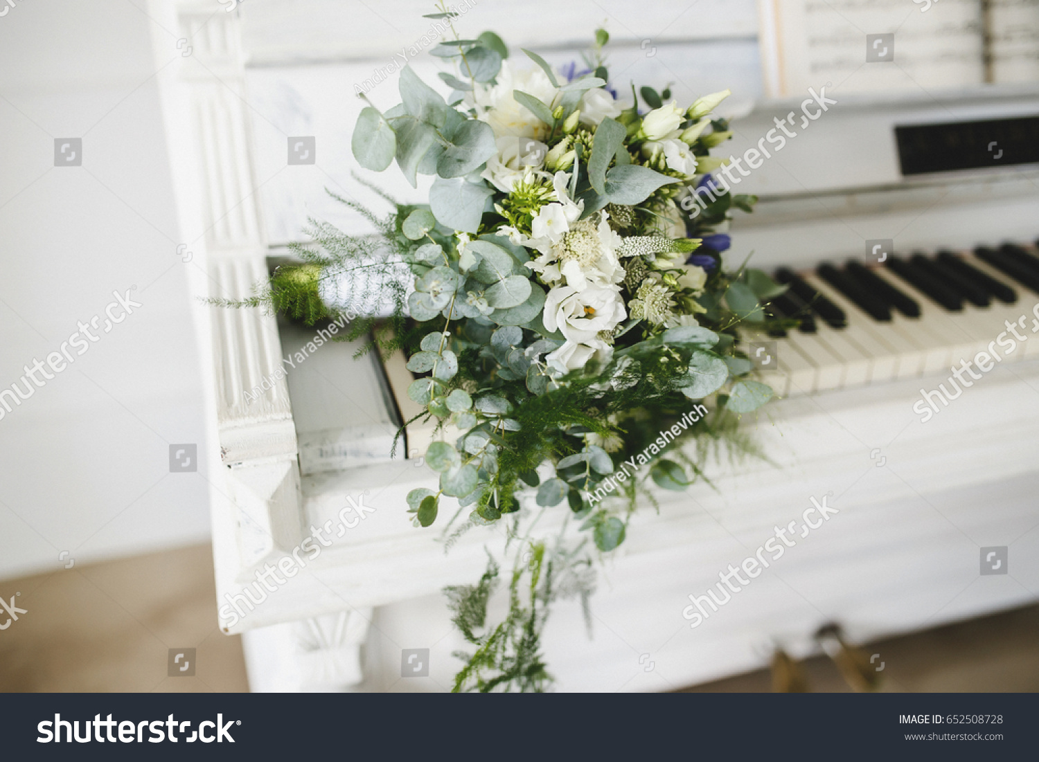 Wedding bouquet natural flowers lies on stock photo edit now a wedding bouquet of natural flowers lies on a white piano izmirmasajfo
