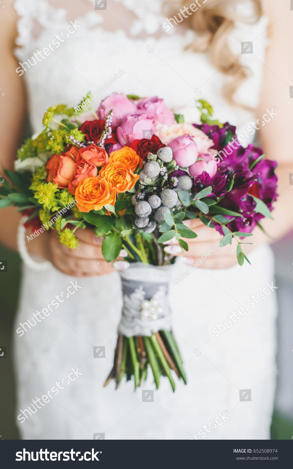 The bride is holding a wedding bouquet from natural flowers ez canvas id 652508974 izmirmasajfo