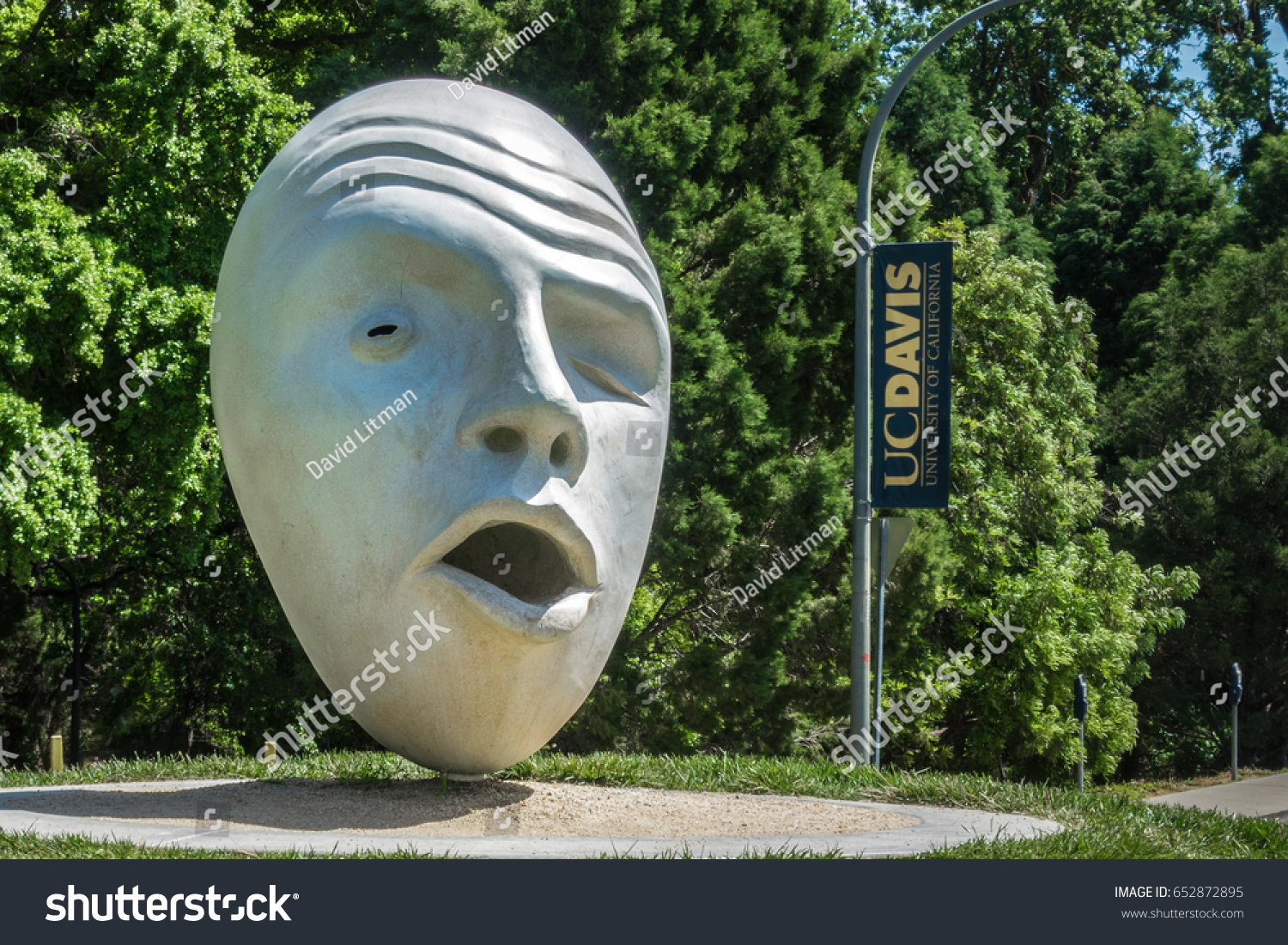 """Davis, California, USA - April 27, 2017: There are seven unique """"Egghead"""" sculptures in various locations throughout the campus of University of California, Davis (UC Davis), home of the Aggies."""