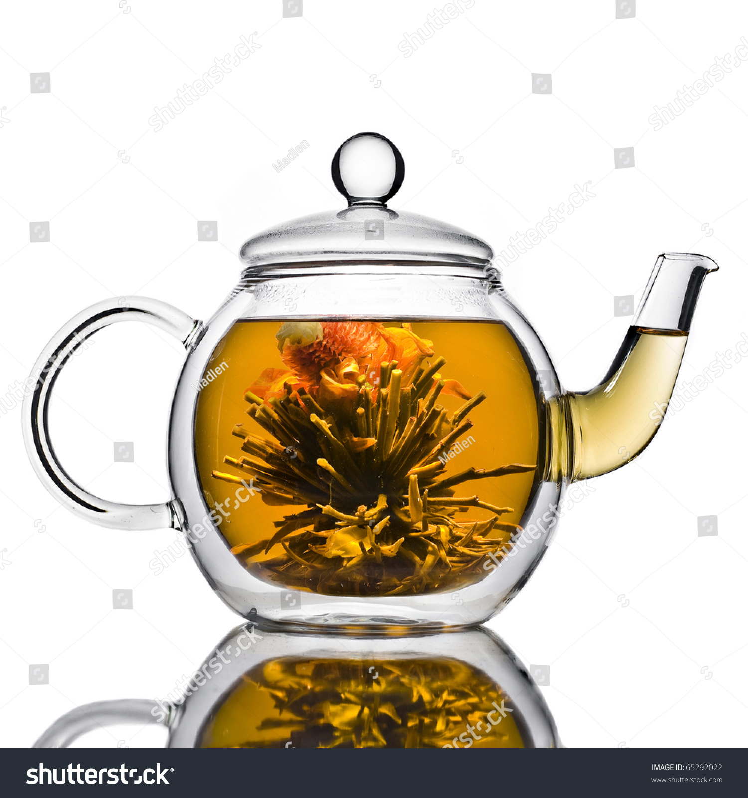 Chinese flower tea - A Glass Tea Pot With Flower Chinese Tea Isolated On A White Background