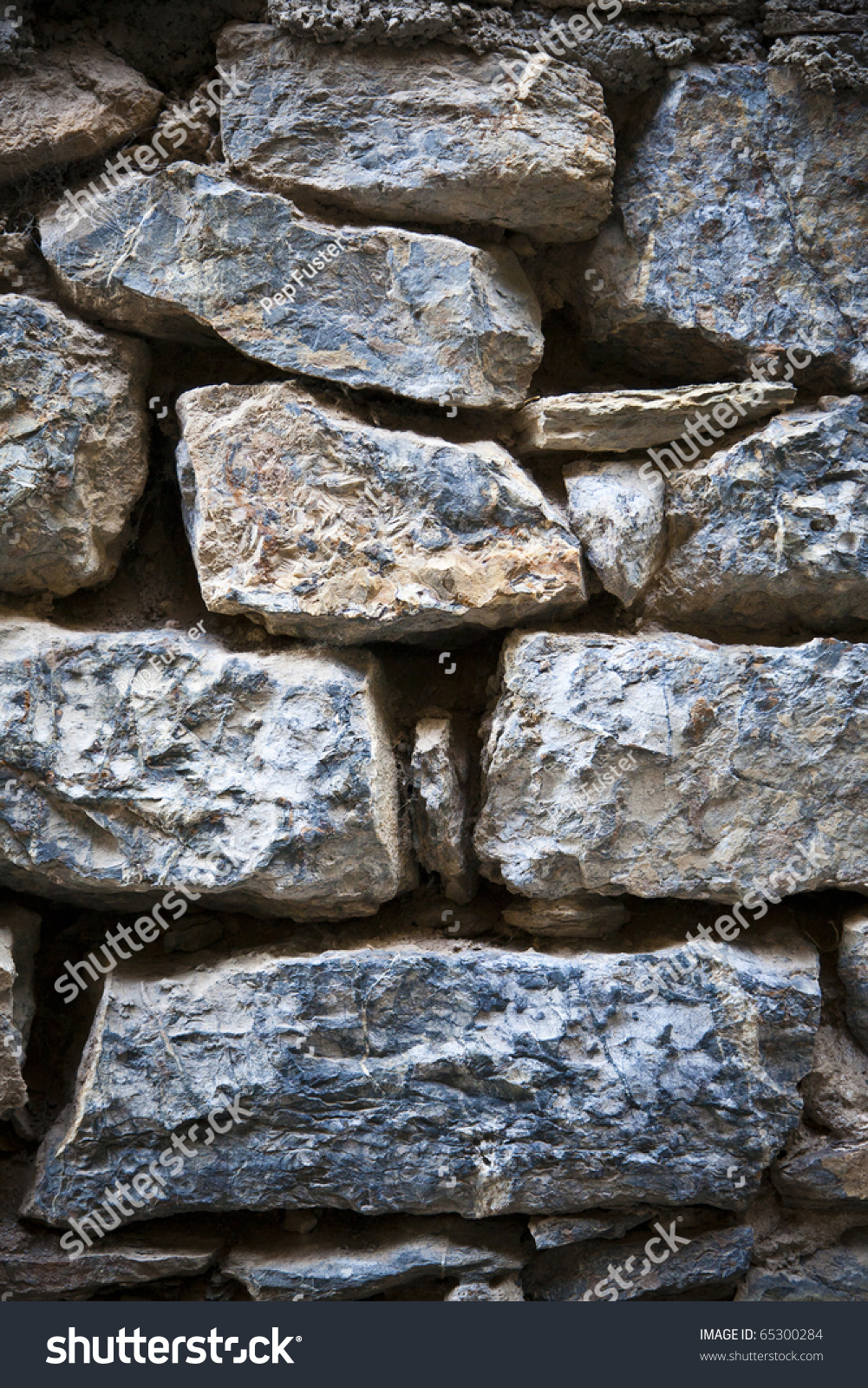Texturas del campo pared de piedra stock photo 65300284 for Texturas de paredes