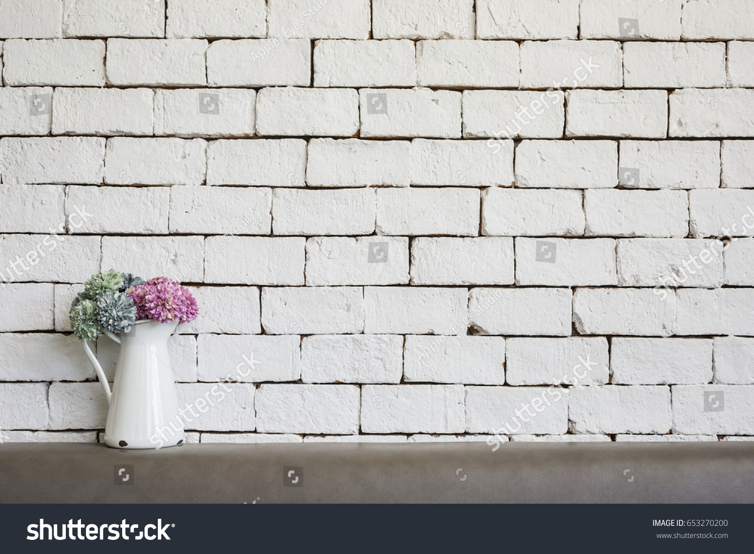 Flowers On White Brick Wall Background Stock Photo Edit Now 653270200