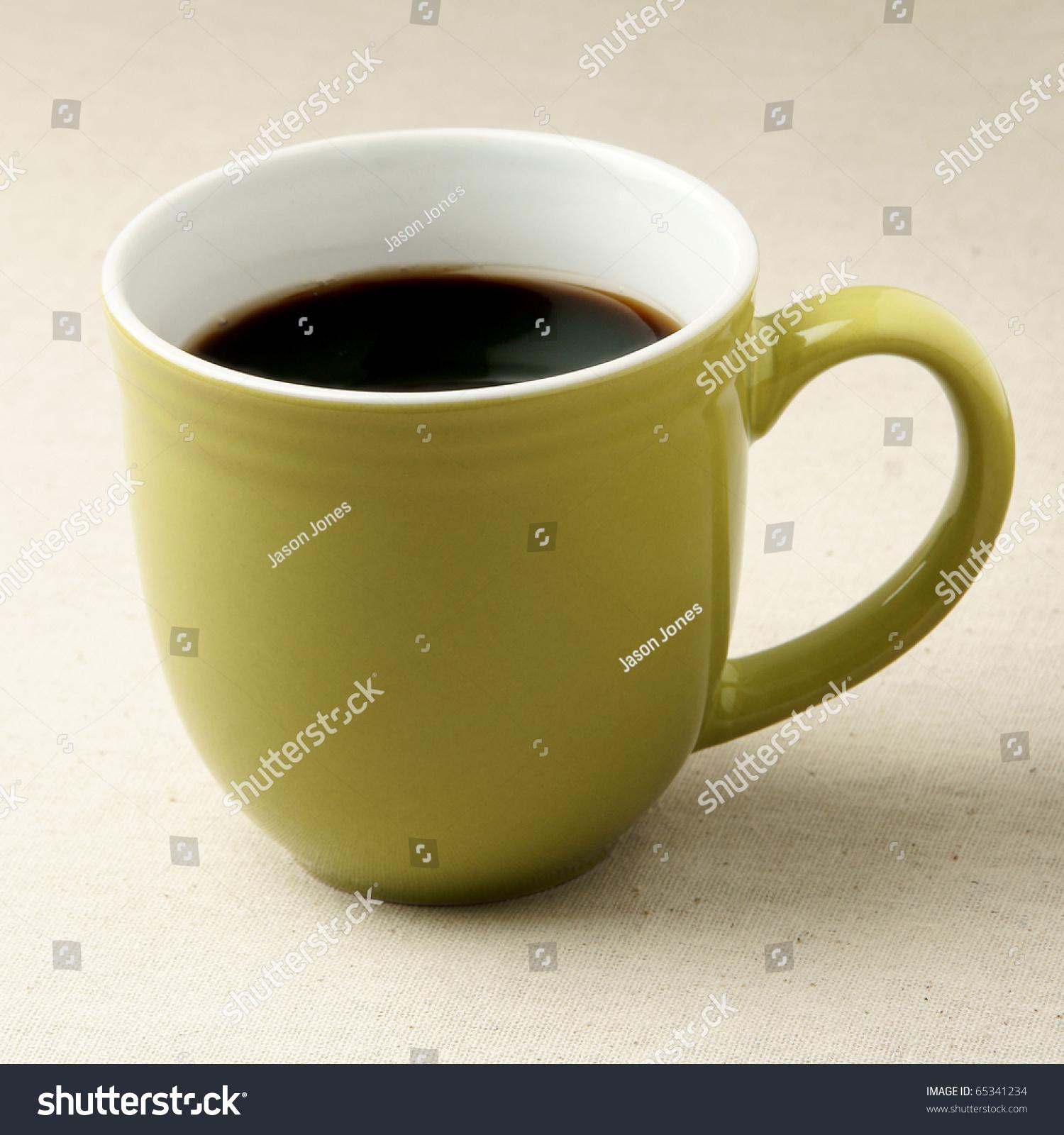 Green Coffee Mug On Rustic Table Cloth Stock Photo