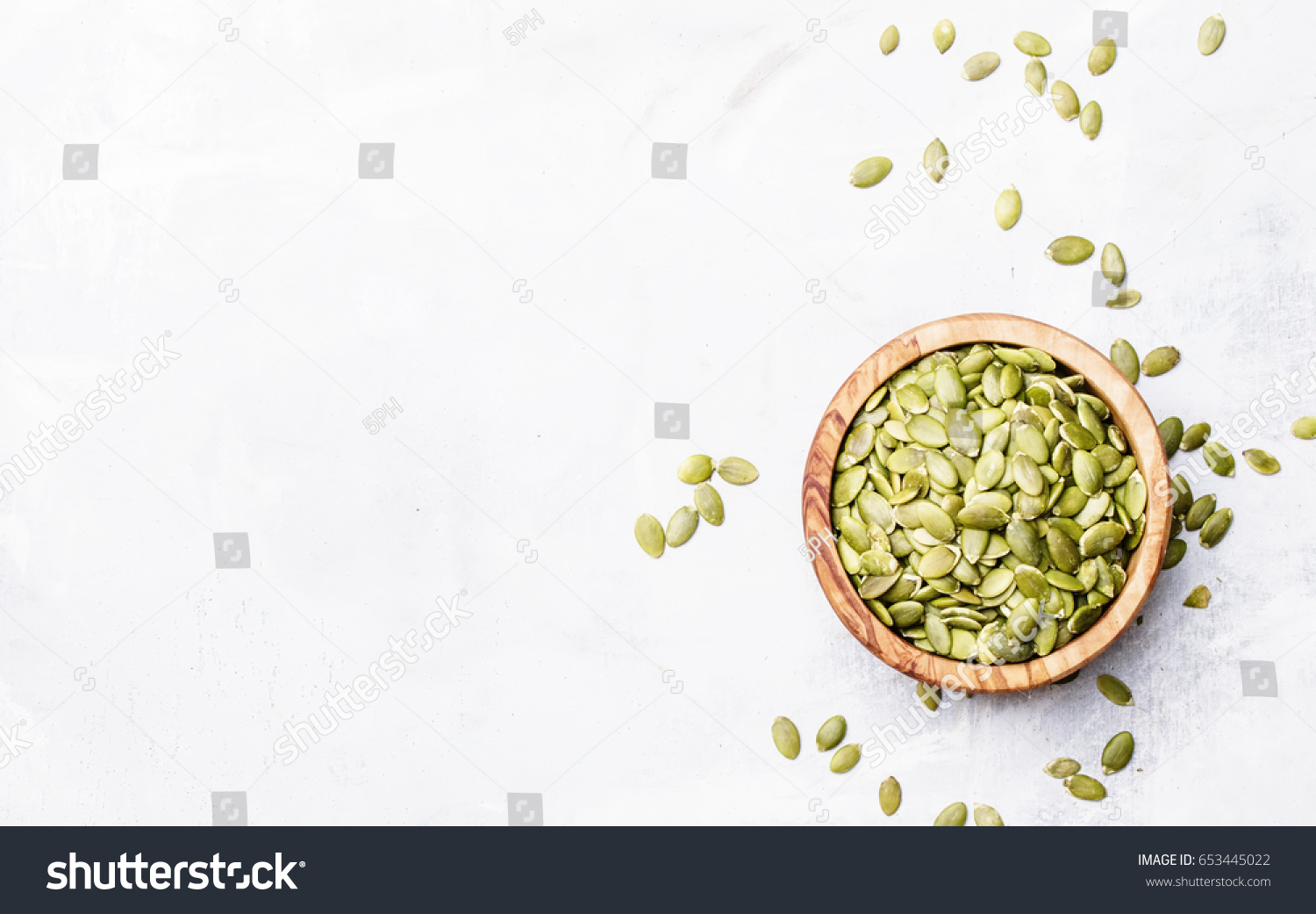Raw pumpkin seeds, food background, top view #653445022