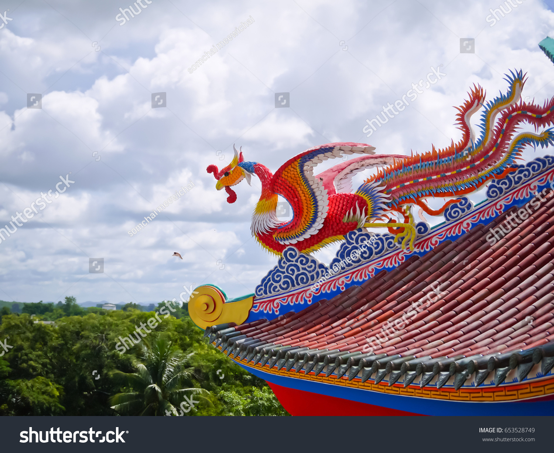 Red phoenix bird on top roof stock photo 653528749 shutterstock red phoenix bird on top the roof in chinese temple voltagebd Choice Image
