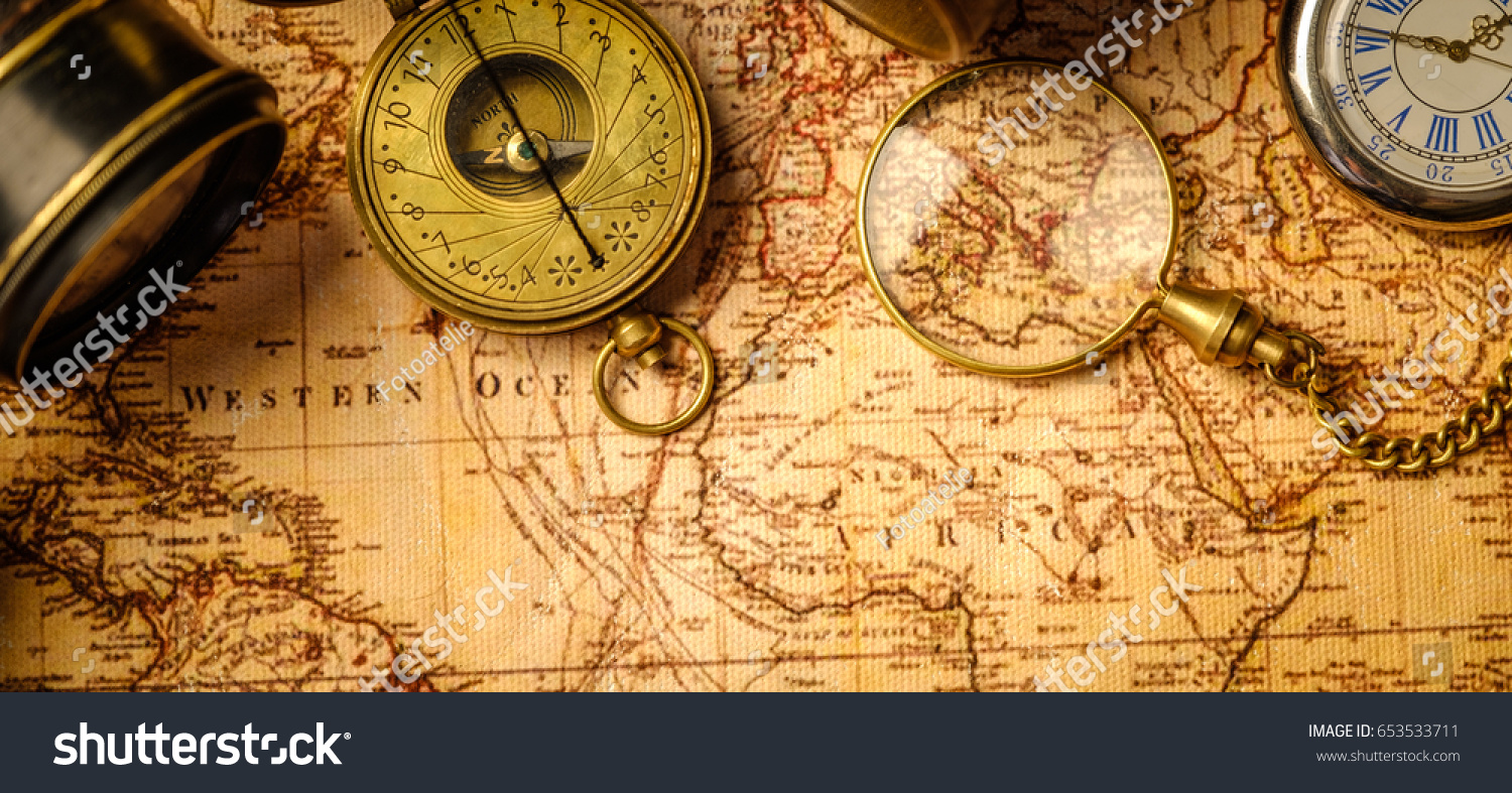 Old vintage retro compass spyglass on imagen de archivo stock old vintage retro compass and spyglass on ancient world map vintage still life travel gumiabroncs Image collections