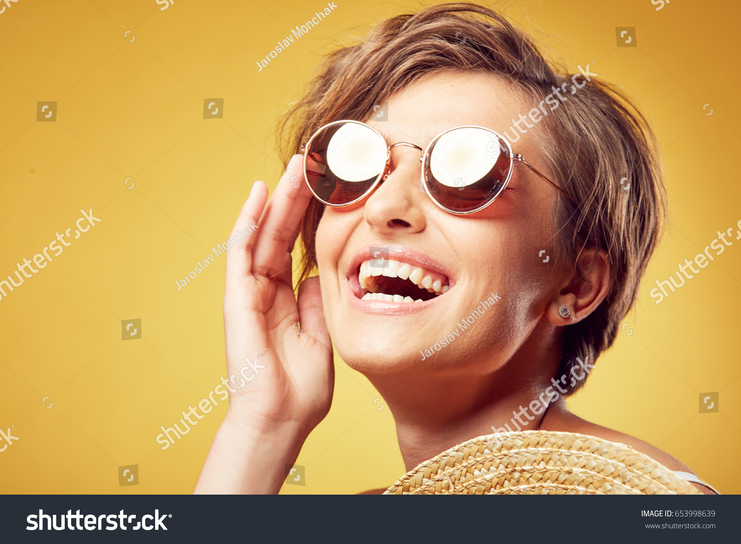 c332a4ddb576 Closeup portrait of sexy young pretty woman with short disheveled brown  hair and sunglasses looking up