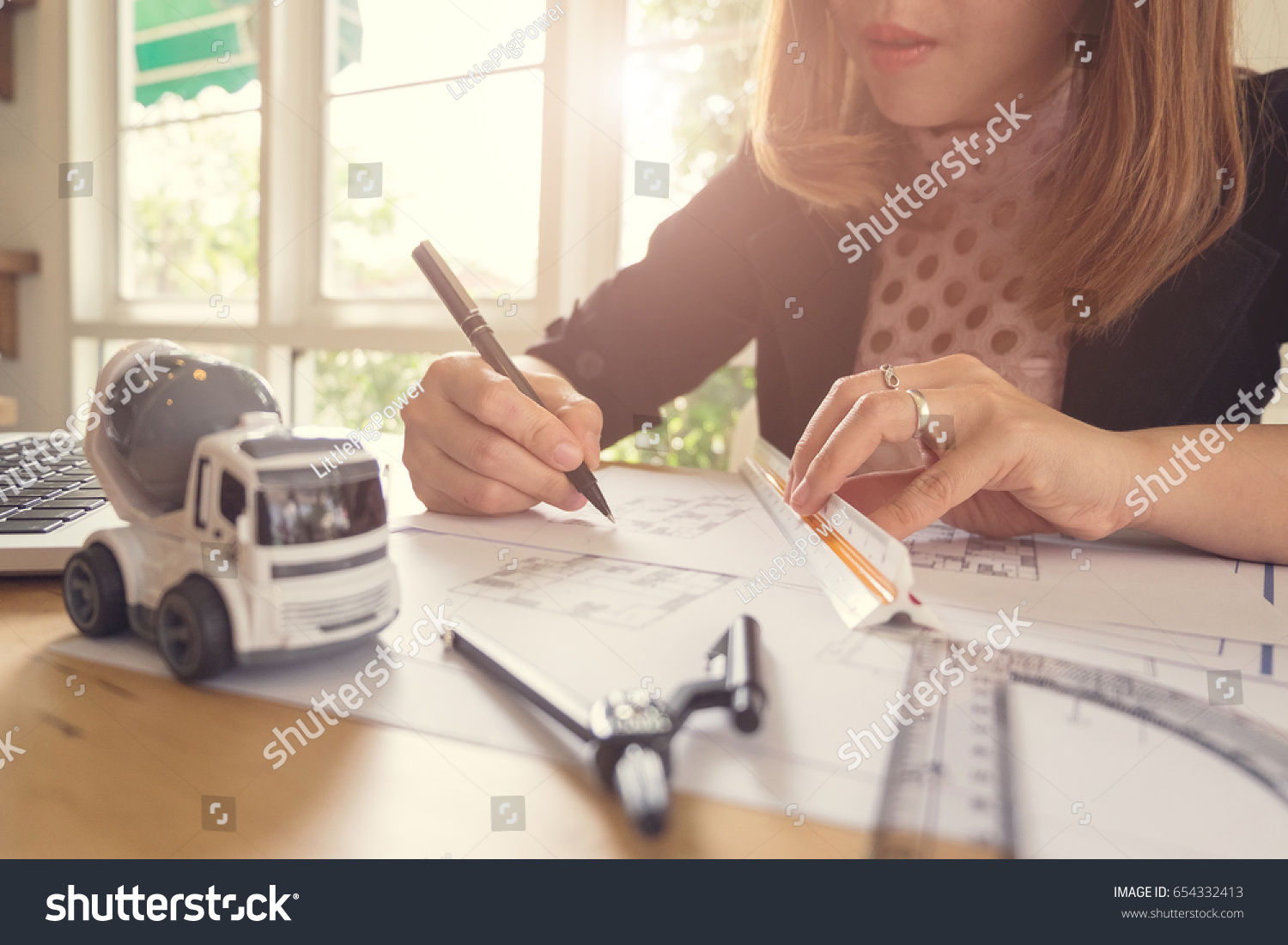 Young business woman drawing blueprint office stock photo young business woman drawing blueprint at office desk malvernweather Image collections