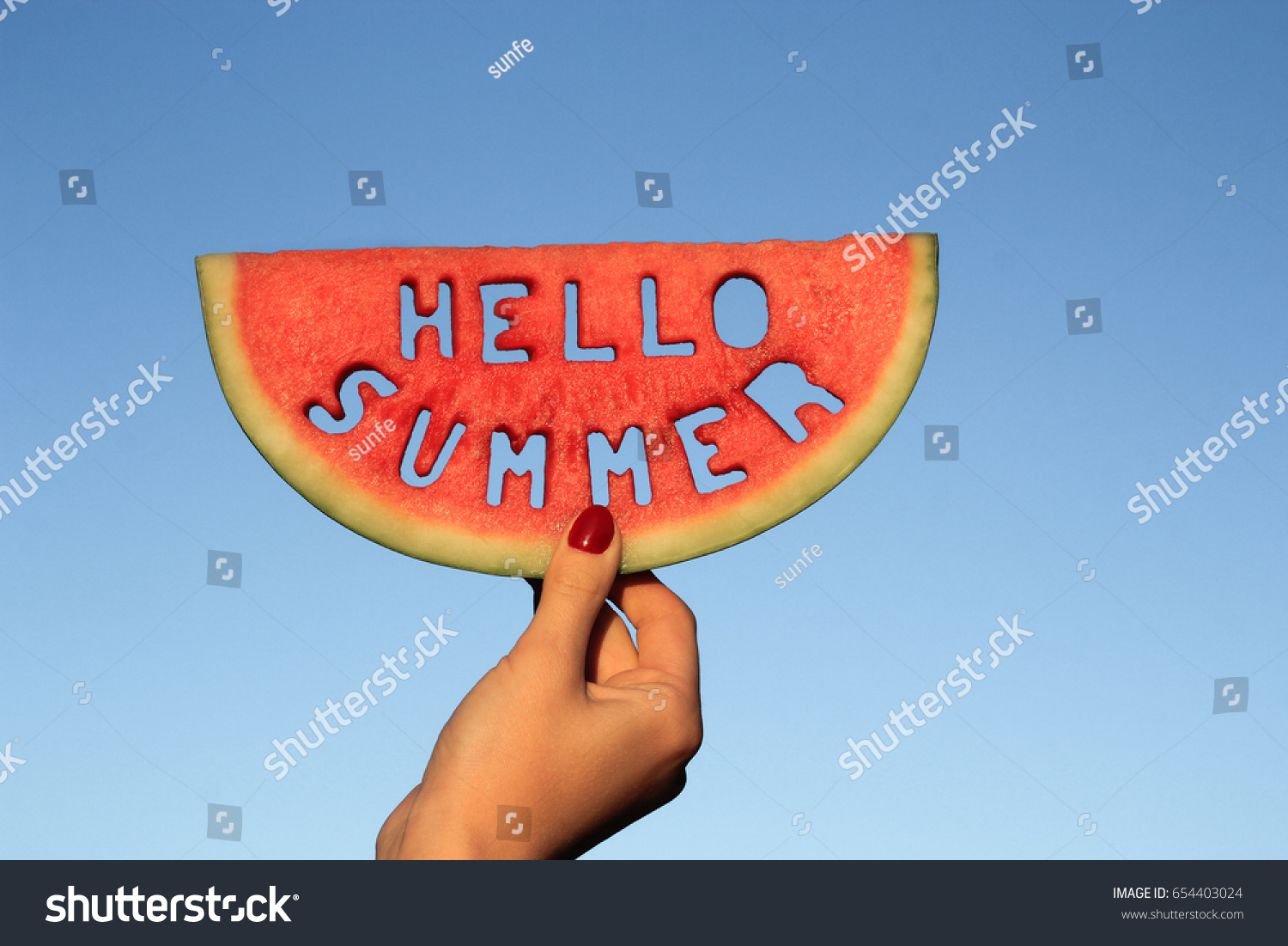 Watermelon Slice With Text Hello Summer, Woman Hands Holding It Against  Blue Sky. Summertime