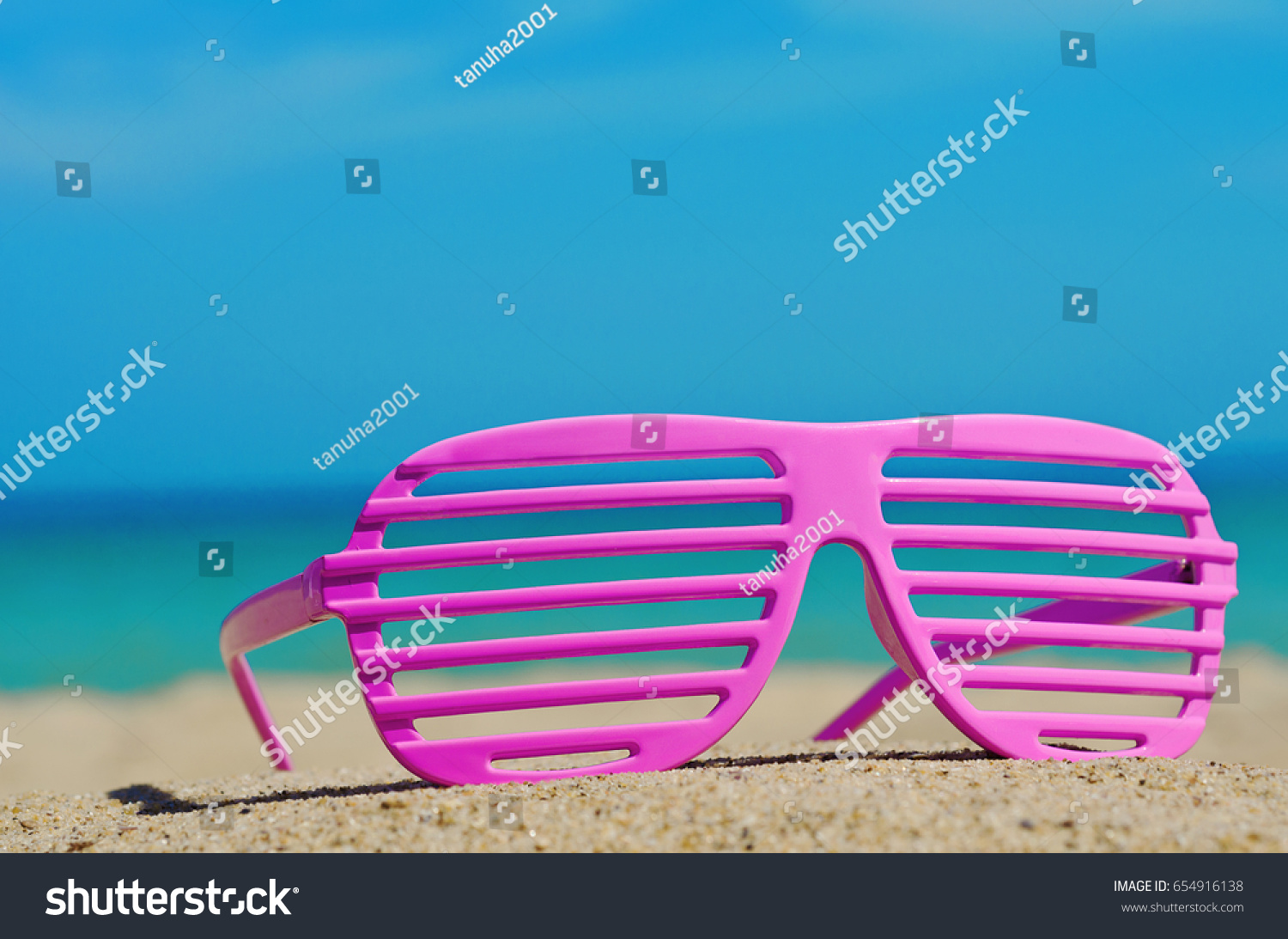 9dcb6f4658f6 Pink Sunglasses On Sandy Beach Stock Photo (Edit Now) 654916138 ...
