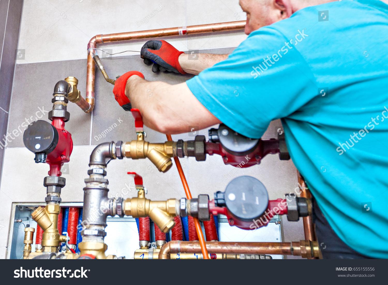 Plumber Assembles Boiler Room Monter Installs Stock Photo (Edit Now ...