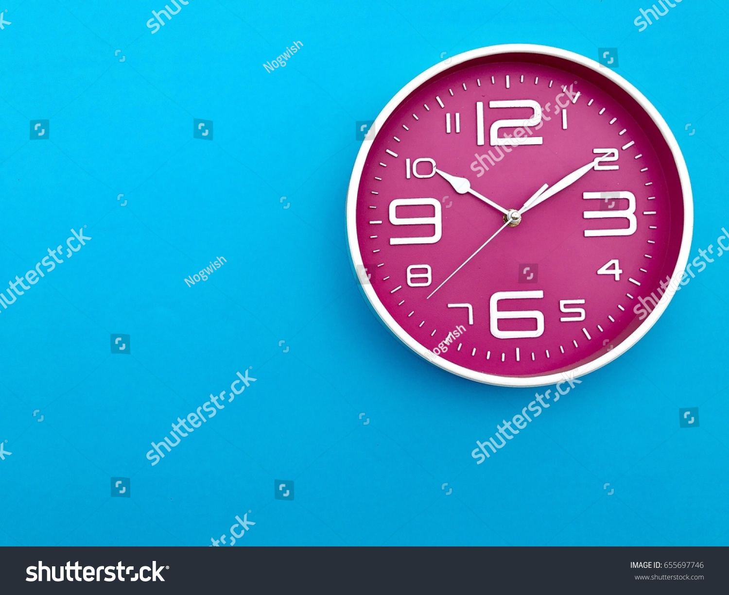 Closeup pink wall clock set on stock photo 655697746 shutterstock closeup pink wall clock set on blue background the concept of the time is amipublicfo Image collections