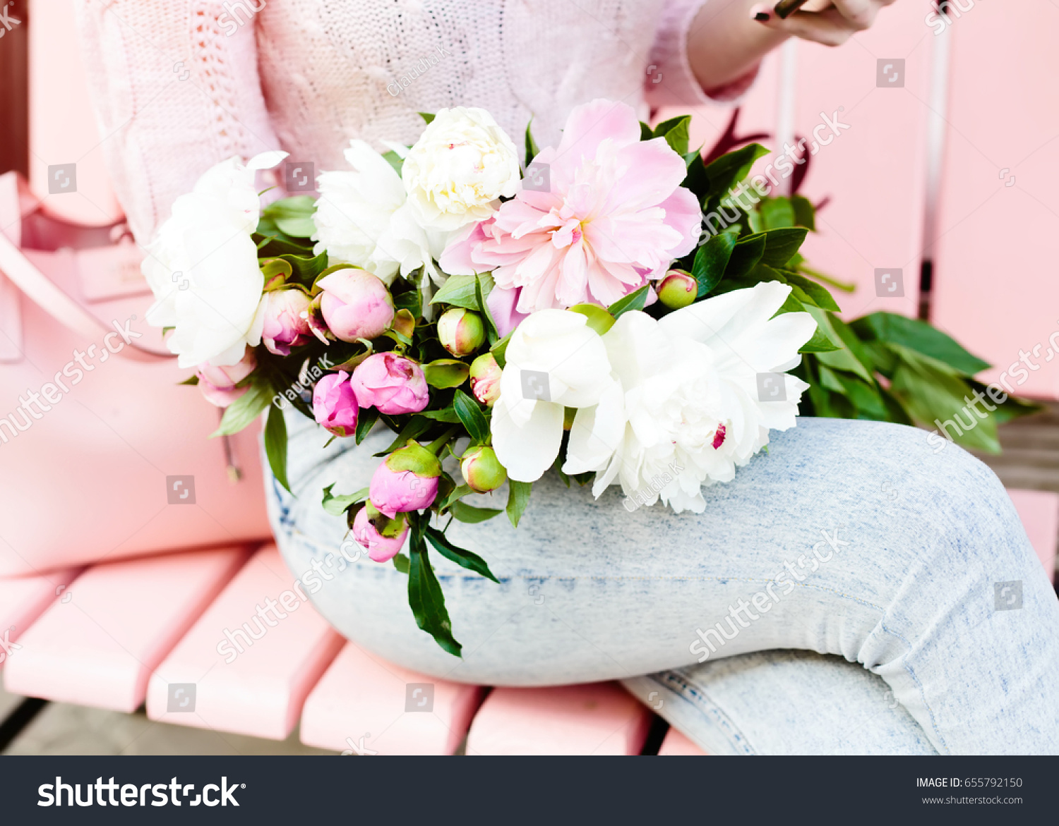 Young woman holding beautiful bunch peons stock photo royalty free young woman holding a beautiful bunch of peons in her hands spring present for a izmirmasajfo Image collections