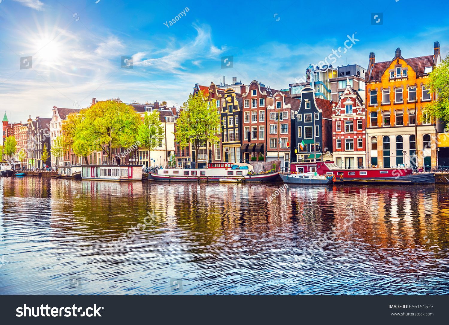 Amsterdam Netherlands dancing houses over river Amstel landmark in old european city spring landscape. #656151523