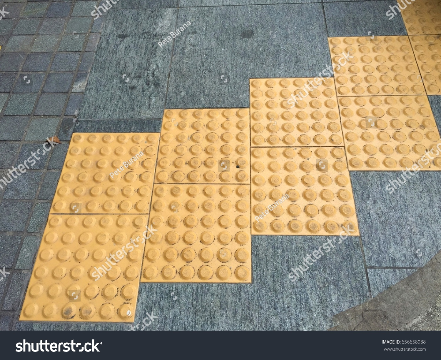 Yellow tactile paving anti slip truncated stock photo 656658988 yellow tactile paving anti slip truncated domes detectable warnings ground surface indicators dailygadgetfo Image collections