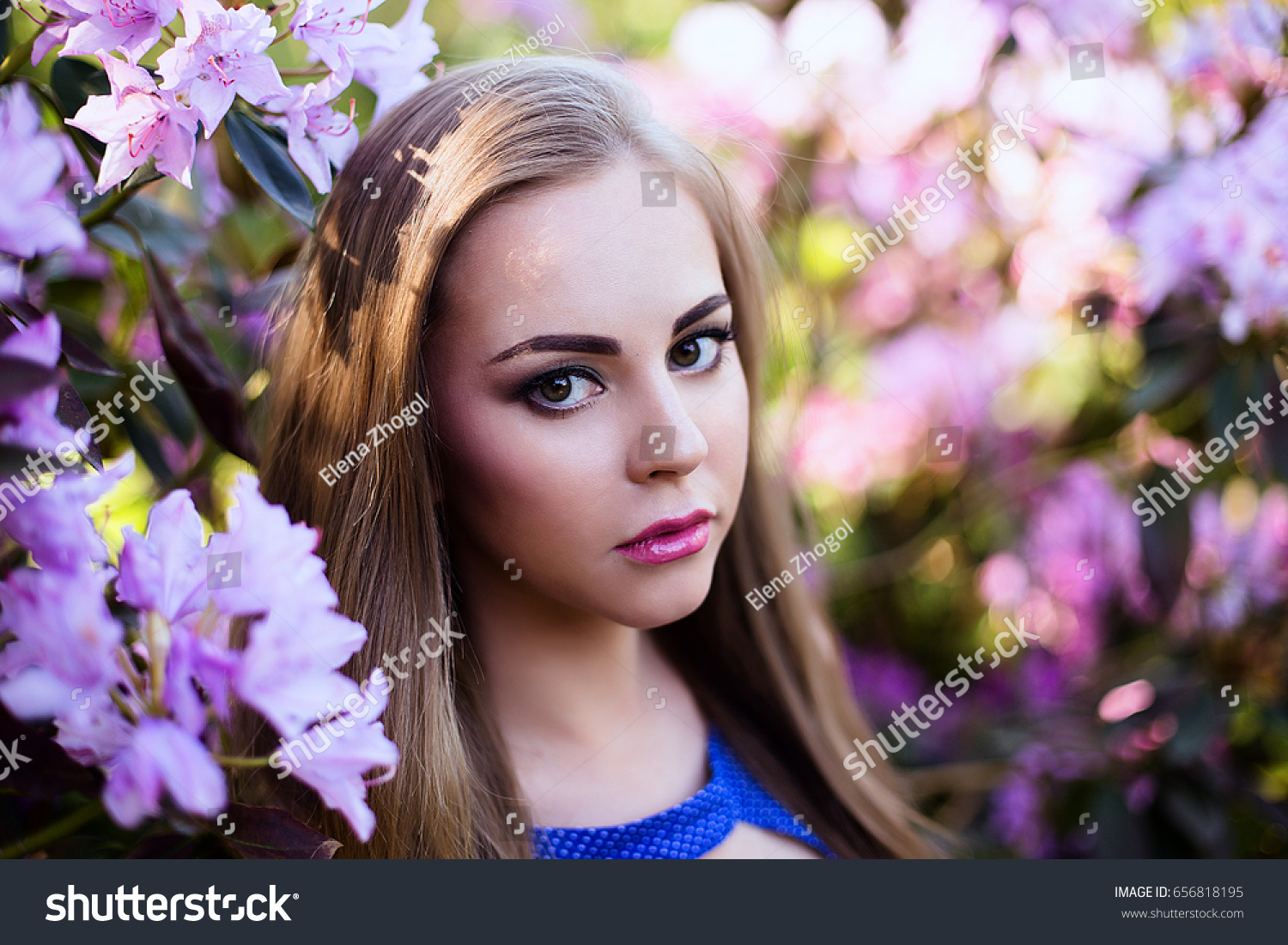 Portrait girl blue dress garden flowers stock photo 100 legal portrait of girl in blue dress in garden with flowers with beautiful hair and makeup izmirmasajfo