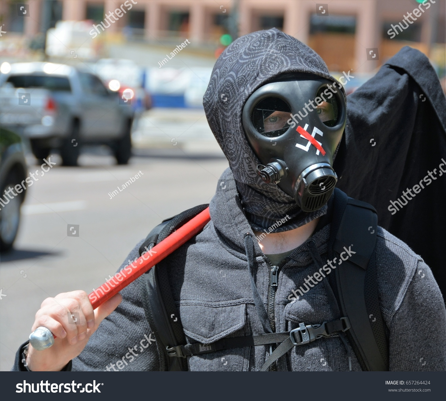 Protester wearing gas mask nazi symbol stock photo 657264424 protester wearing gas mask with nazi symbol on it at the act for america rally in biocorpaavc Gallery