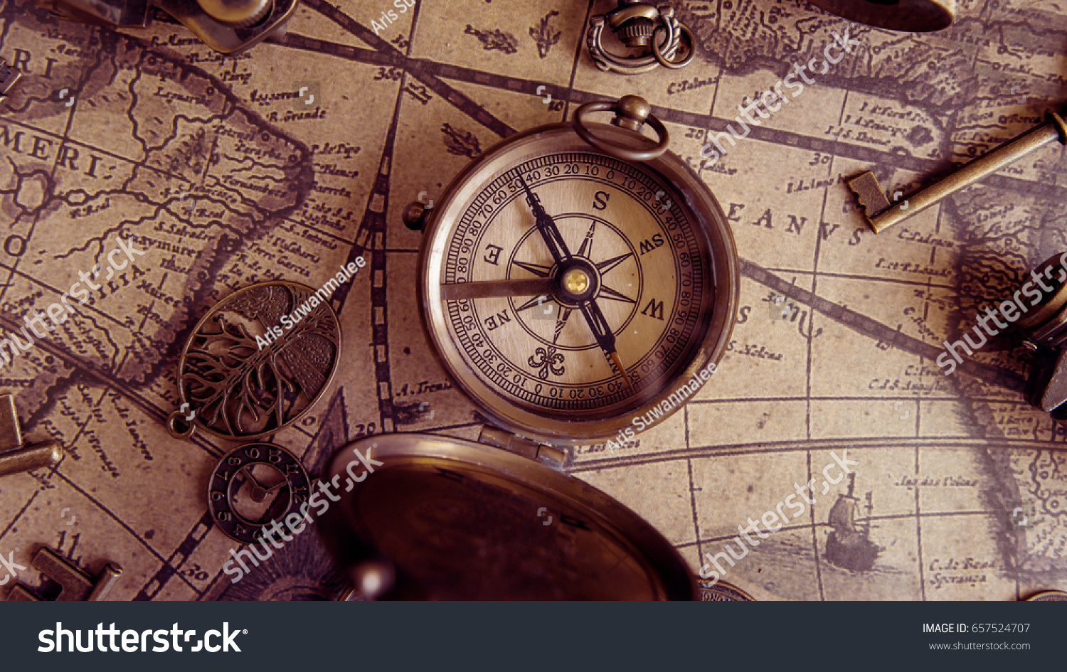 Antique compass on ancient world map stock photo edit now antique compass on ancient world map gumiabroncs Gallery