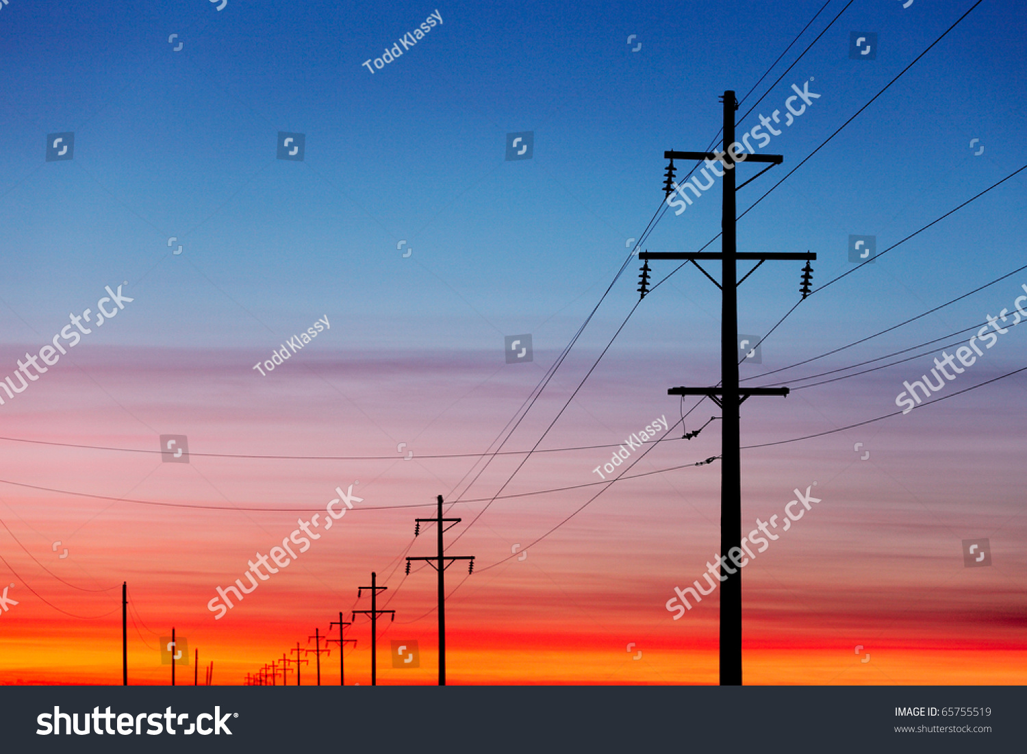 A Silhouette Of High Voltage Power Lines Against A ...