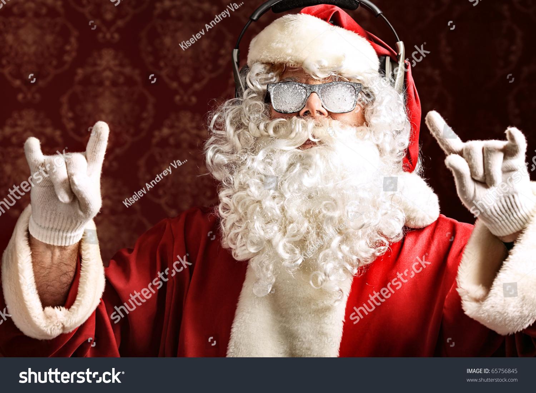 santa claus listening music headphones christmas stock photo