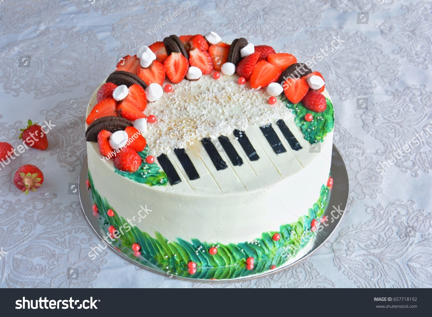 Birthday Cake Decorated With Fondant Rounded Symbolically Presenting Piano And Cello Instruments On White