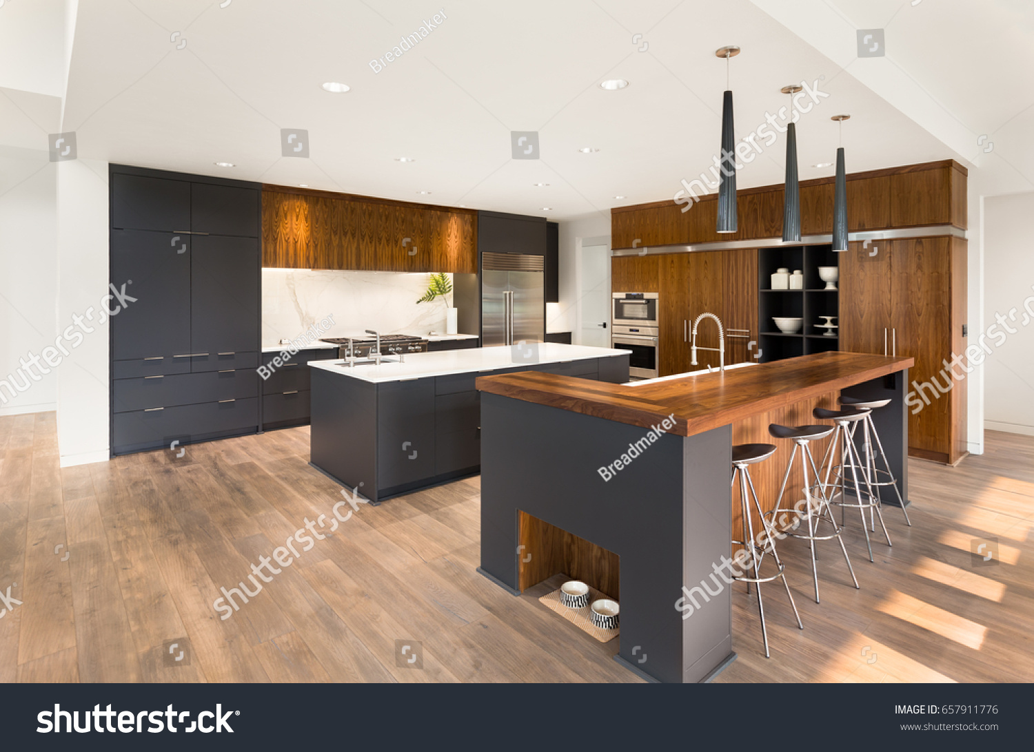 Beautiful Kitchen Interior With Island, Sink, Cabinets, And Hardwood Floors  In New Luxury