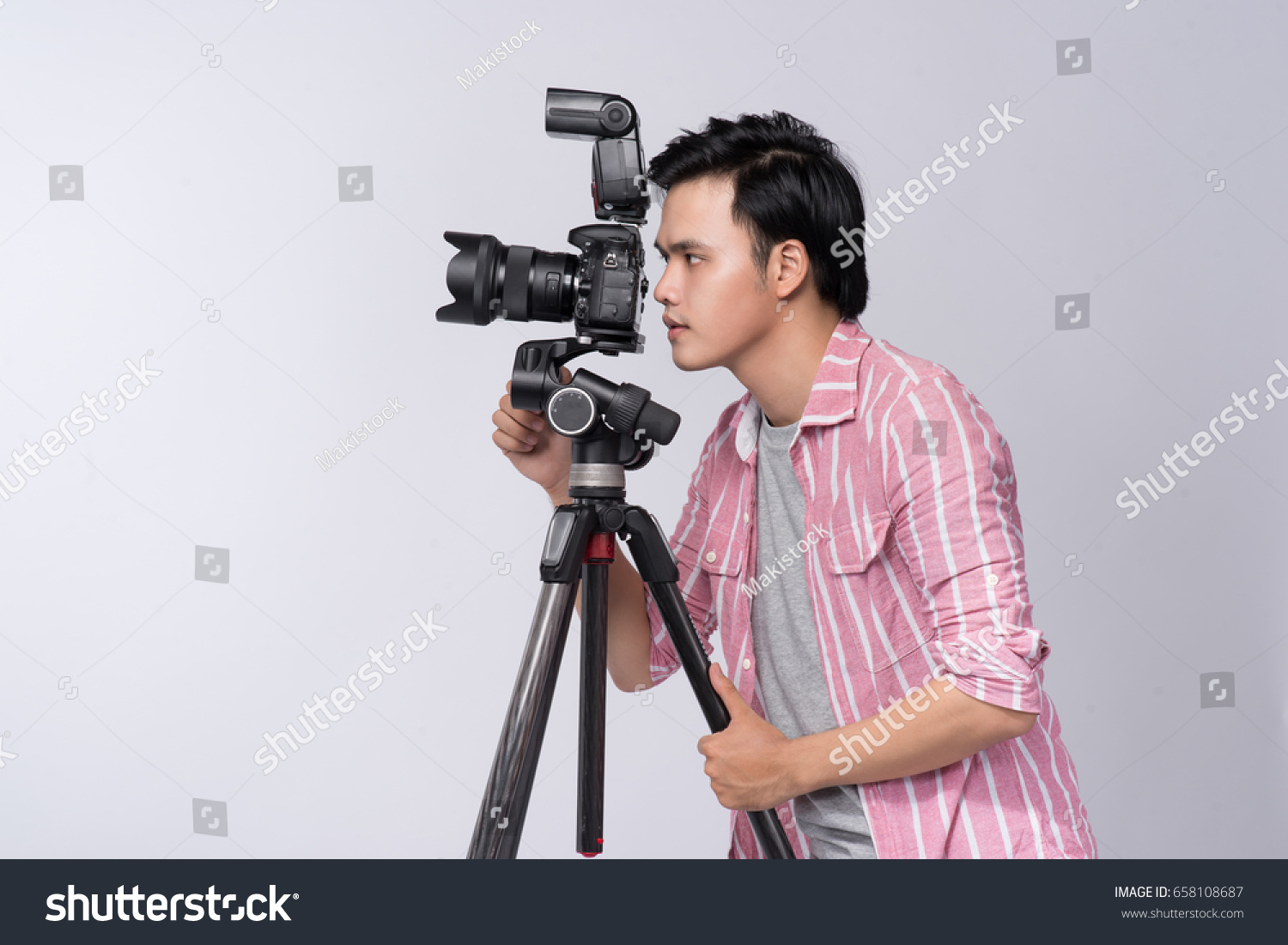Young Asian Photographer Holding Digital Camera Stock Photo Edit Working Of Cameras While In Studio