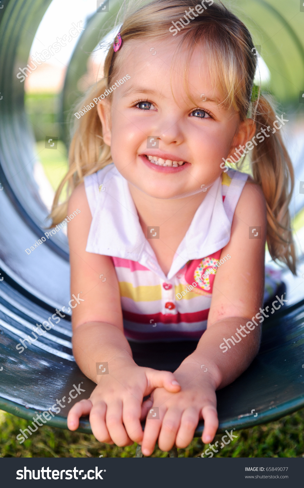 Cute Stock Photography: Cute Girl Poses Tunnel Playground Stock Photo 65849077