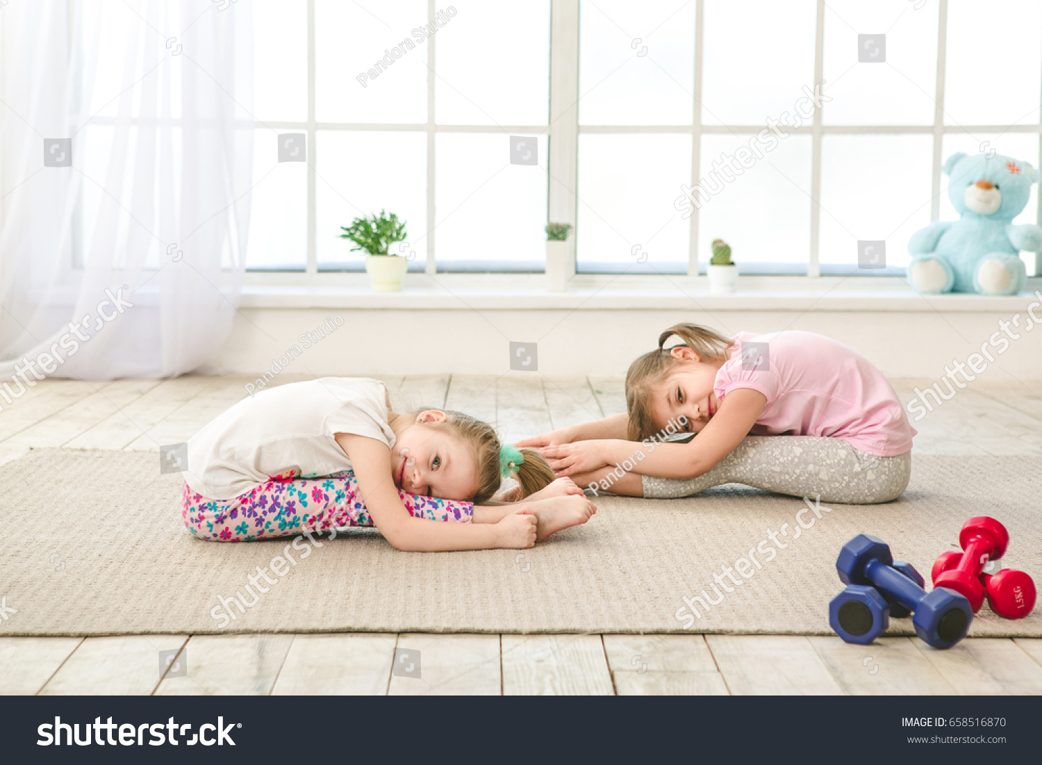 little kids girls sisters exercise together indoors - Images Of Little Kids