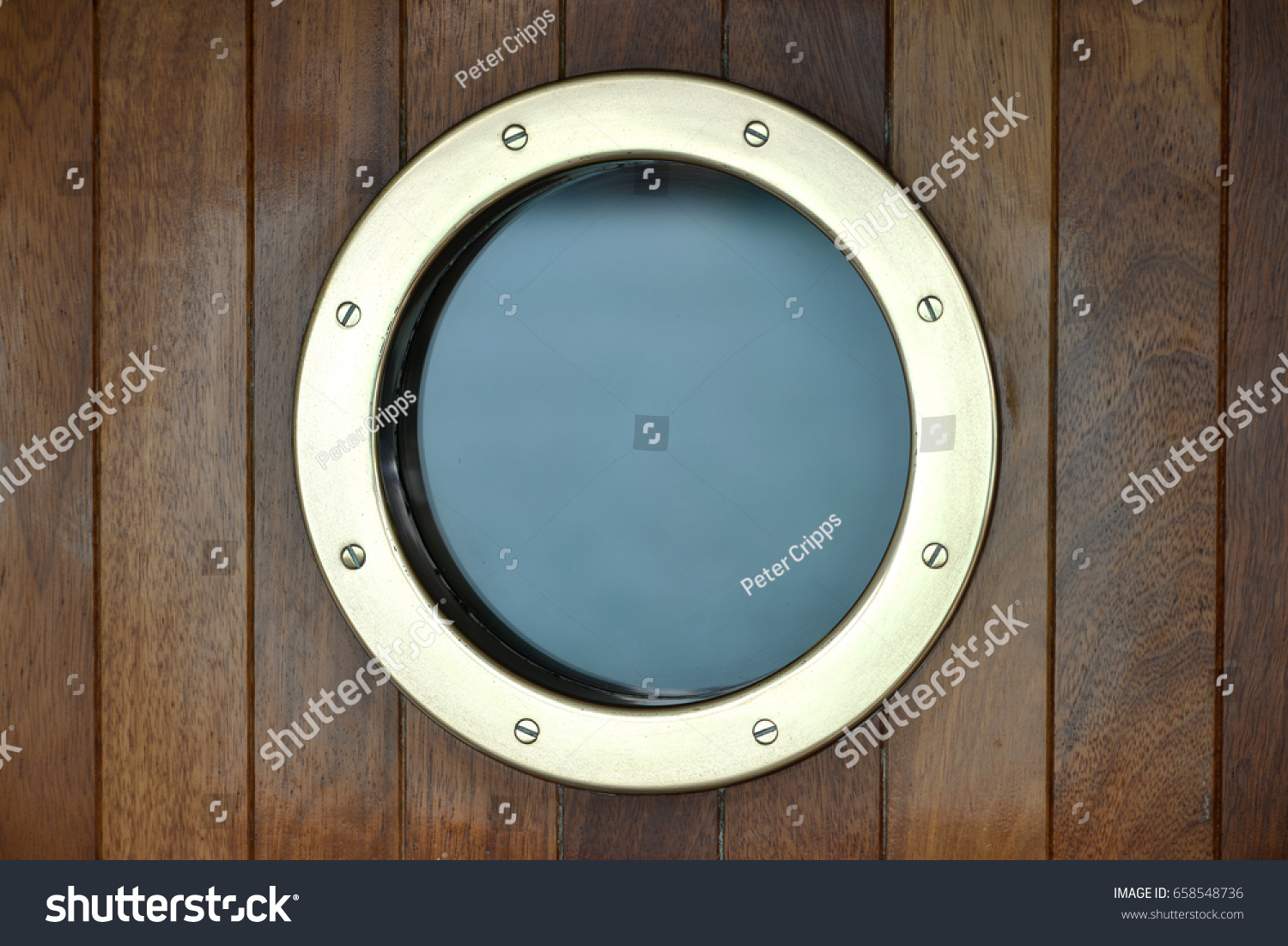 Brass Porthole Window In A Wooden Ships Door