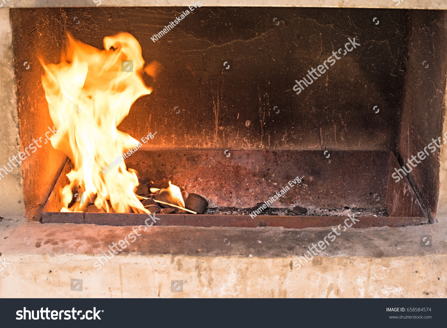 the fireplace man couple in ski lodge by fireplace man stoking