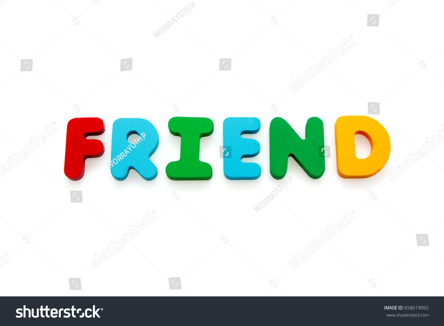 wooden letters spelling the word friend isolate on white background