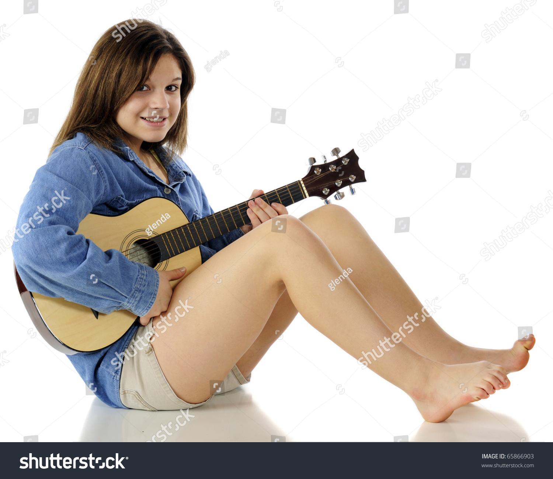 Happy Beautiful Young Teen Sitting Barefoot Stock Photo