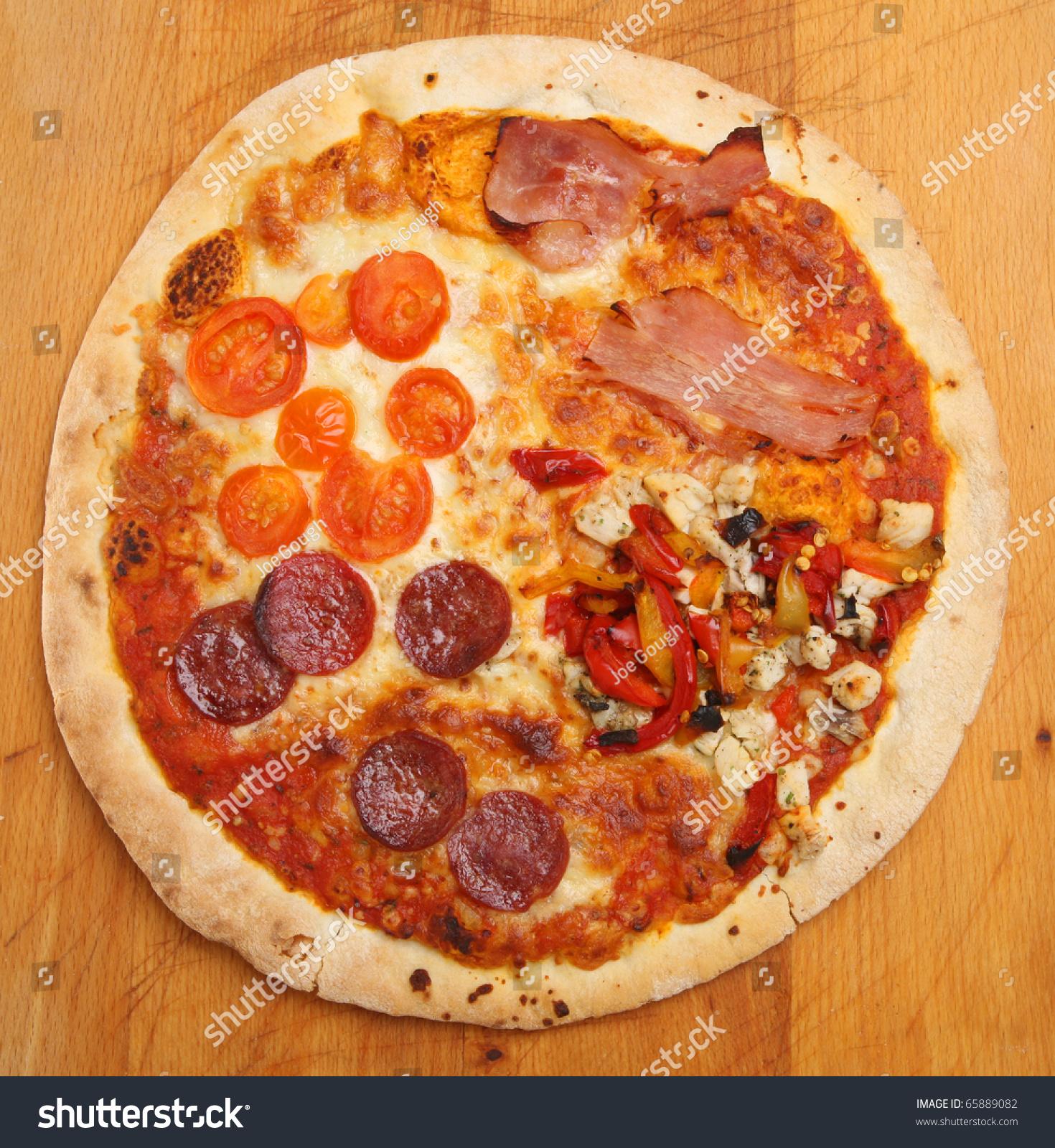 pizza 39 quattro stagioni 39 stock photo 65889082 shutterstock. Black Bedroom Furniture Sets. Home Design Ideas