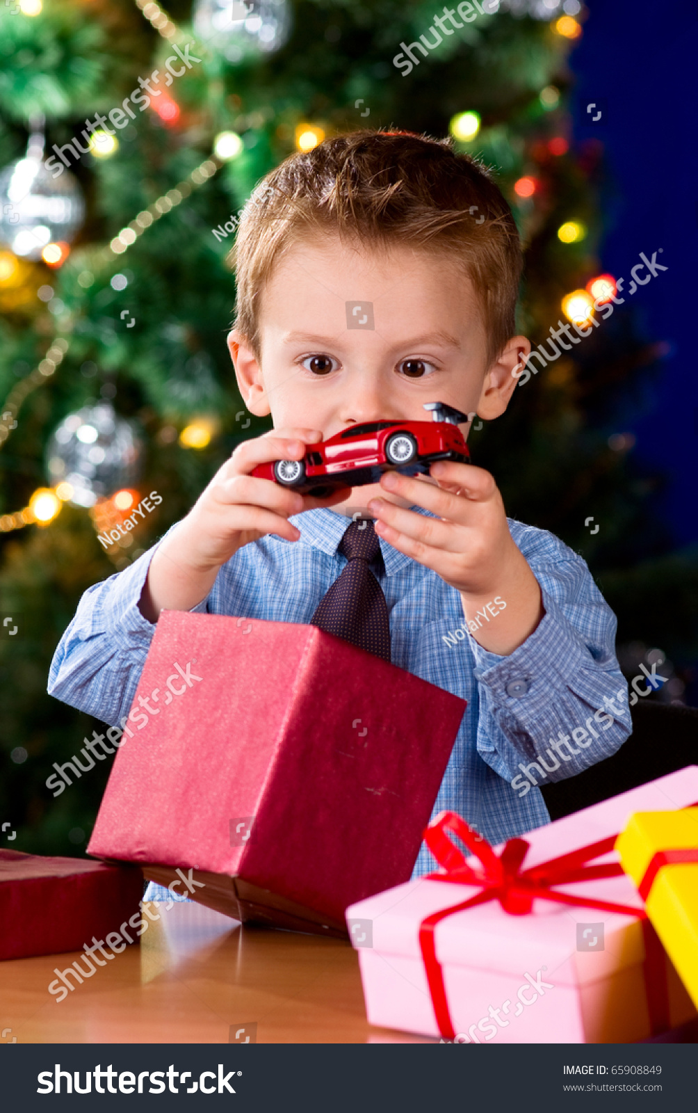 Happy Little Boy Opening Christmas Gifts Stock Photo (Edit Now ...