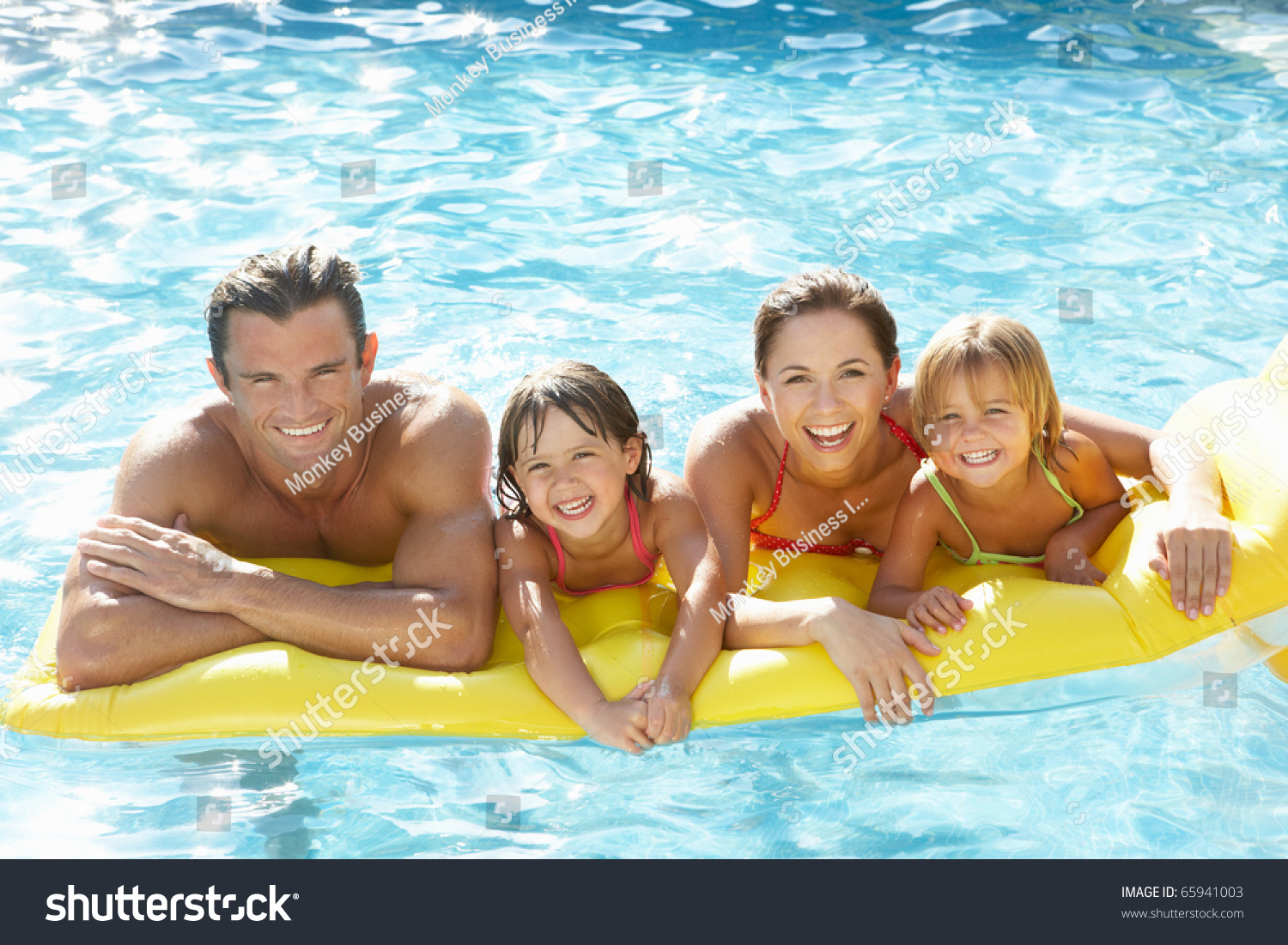 Nudist children Young family, parents with children, in pool