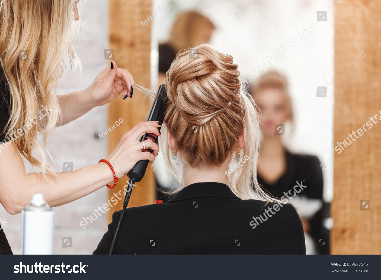 business woman lady boss in beauty salon making hairdress and looking to the mirror #659987545