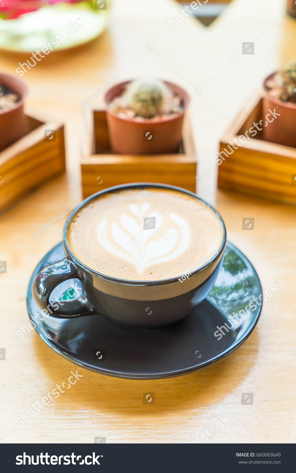 Hot latte coffee cup on table stock photo 660069649 shutterstock hot latte coffee cup on table geotapseo Gallery