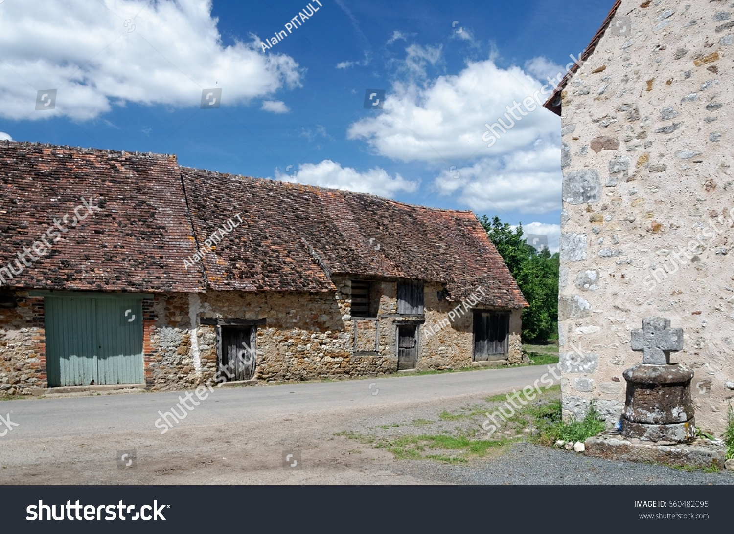A view of old country houses with wooden doors and red tile roofs the stone