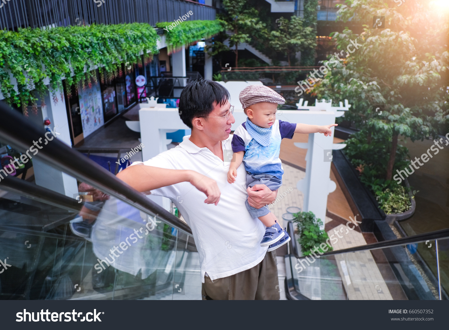 Father and son spending time shopping, Cute little Asian 1 year old toddler  baby boy