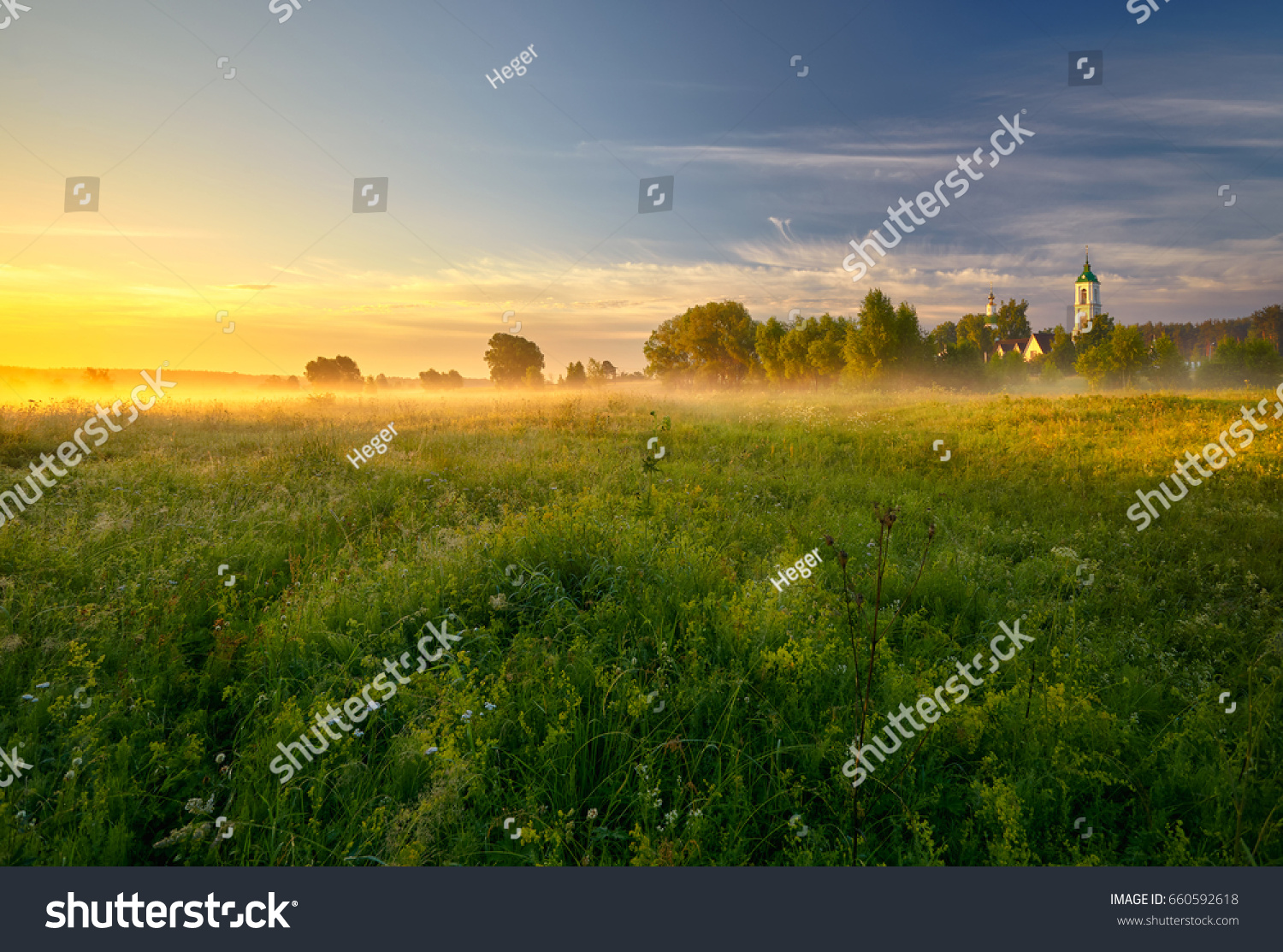 Field With Flowers Sunrise And Church In The Distance