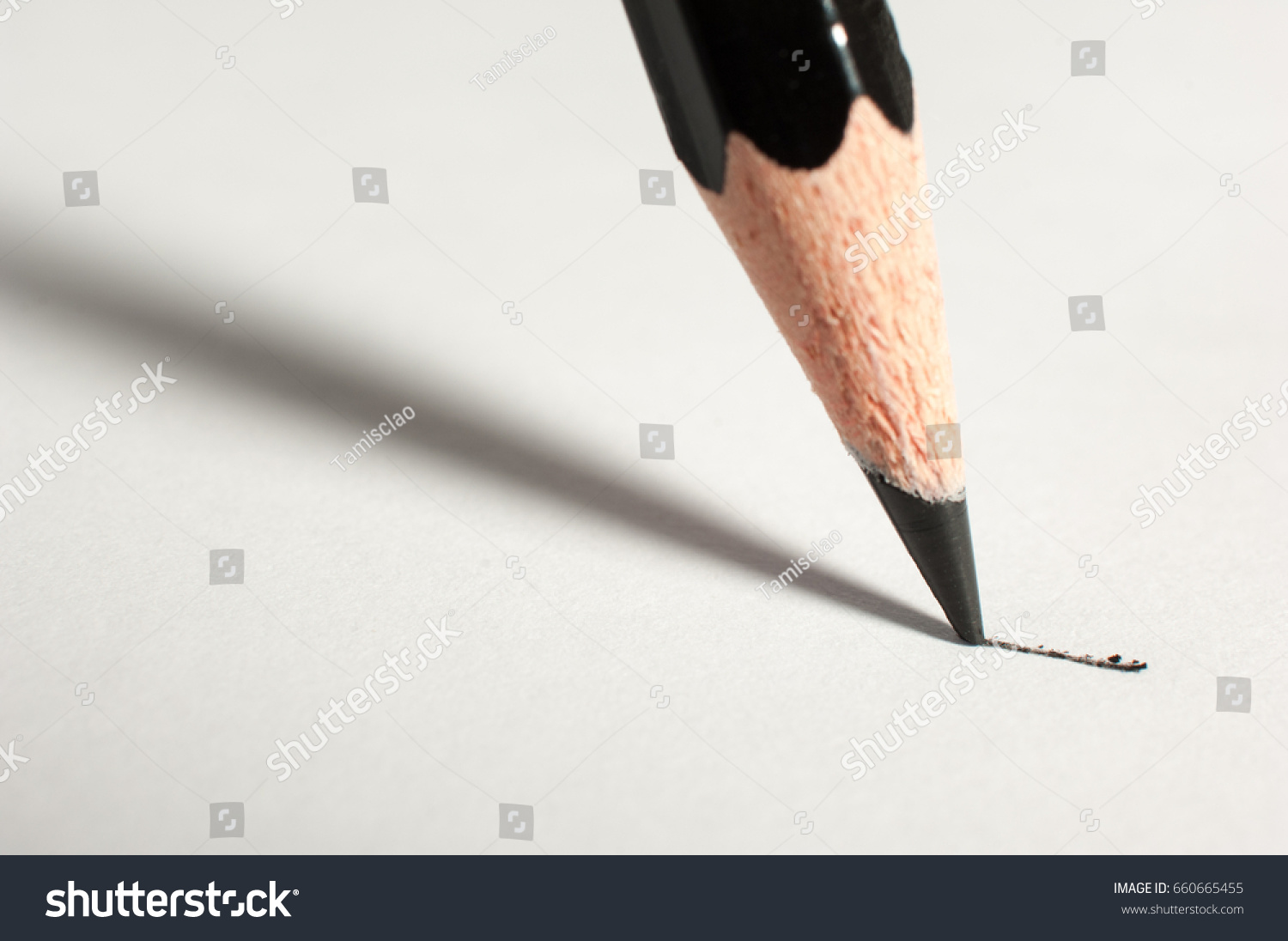 close pencil writing on paper stock photo (edit now) 660665455
