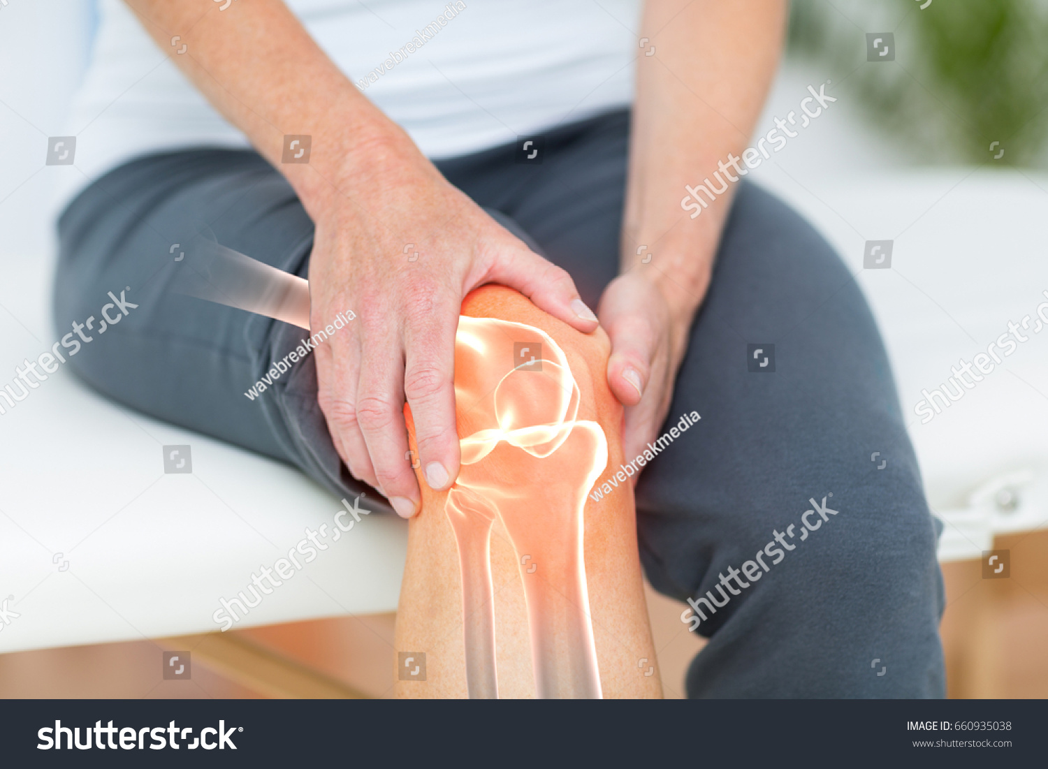 Digitally composite image of man suffering with knee cramp  #660935038
