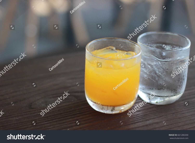 Glass Fresh Orange Juice Drinking Water Stock Photo (Edit Now) 661280200