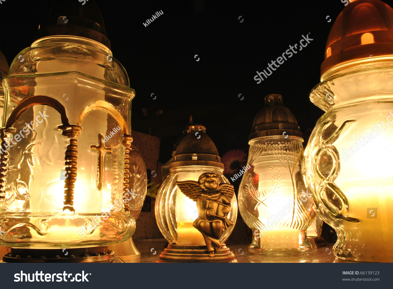 Lightning candles on tombstone stock photo royalty free 66139123 lightning candles on the tombstone arubaitofo Images