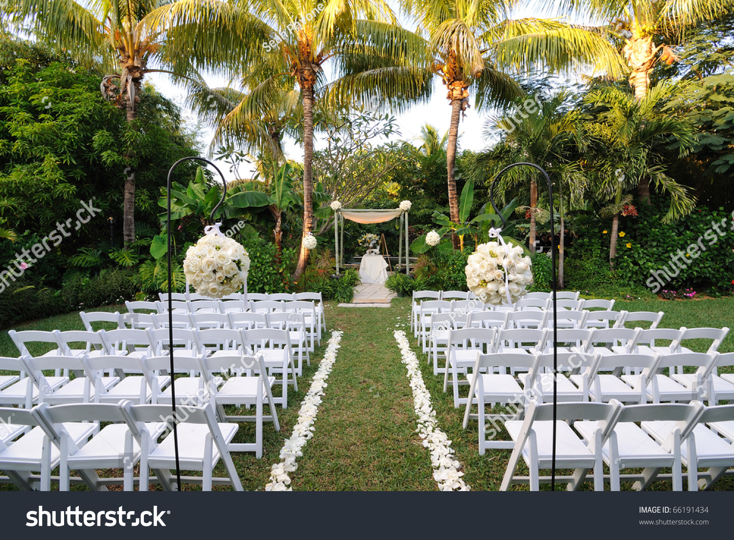 Wedding ceremony chair - A Flower Bouquet With Roses In Front Of Rows Of Chairs At A Wedding Ceremony