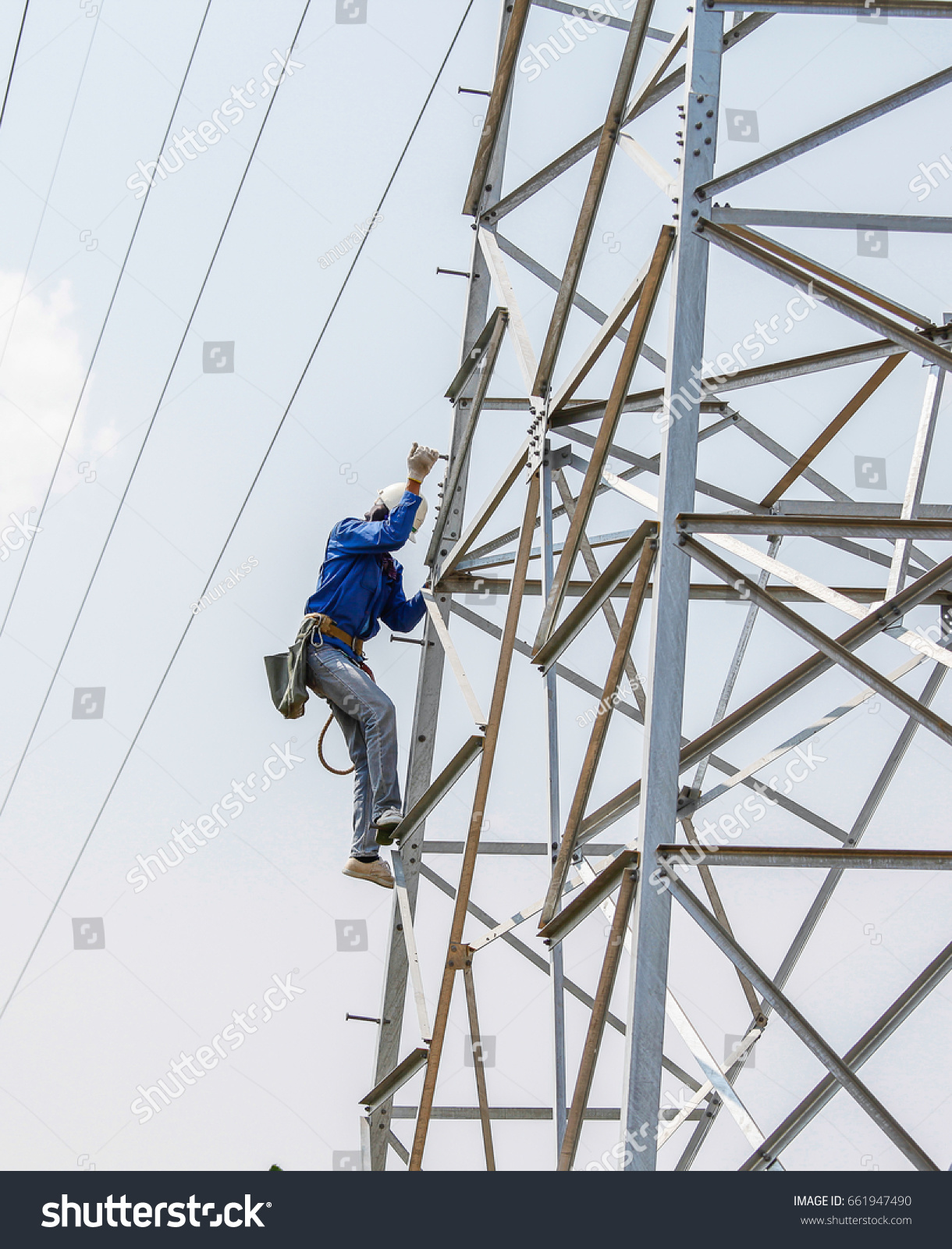 Lineman Climbing On Transmission Line Tower Stock Photo Edit Now 661947490